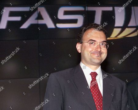 Stock Photo of Founder of Fastweb SpA Silvio Scaglia, left, smiles during the presentation of Fastweb, in Milan, Italy. Italian authorities on Tuesday, Feb. 23, 2010, issued arrest warrants for Scaglia in a crackdown on an alleged money laundering ring. Anti-Mafia prosecutor Piero Grasso said authorities are seeking the arrest of Silvio Scaglia, the founder of Fastweb SpA, the Italian broadband provider that has been bought by Swisscom AG. His whereabouts are unknown