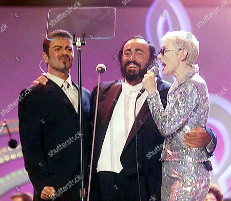 PAVAROTTI MICHAEL LENNOX Italian tenor Luciano Pavarotti, center, US singer George Michael, left, and Annie Lennox of the Euryhtmics perform during the Pavarotti and Friends International benefit concert for Tibetan and Cambodian children, in Modena, Italy