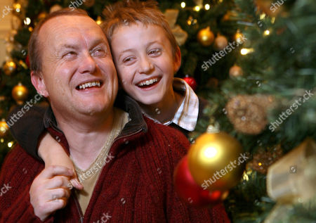 Stock Picture of Mike Tomlinson Husband of Fundraiser Jane Tomlinson Who Died This Year of Cancer with His Son Steven