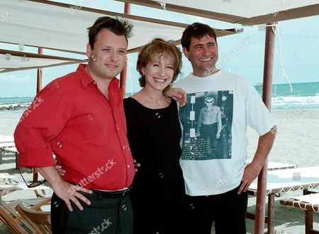 """FONTEYNE BAYE LOPEZ From left Belgian Director Frederic Fonteyne, French actress Nathalie Baye, and Spanish actor Sergi Lopez pose for photographers in Venice, Italy, during the 56th Venice Film Festival, . The three are presenting the competition film '""""A Pornographic Liaison"""