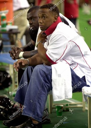 ANDERSON SMITH Atlanta Falcons' running back Jamal Anderson, right, watches the game on the bench with running back Maurice Smith during the NFL preseason match against the Dallas Cowboys at Tokyo Dome in Tokyo . Because of an injury, Anderson did not play