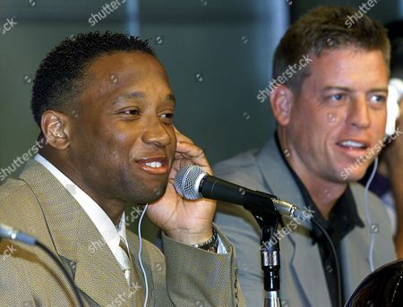 ANDERSON AIKMAN Atlanta Falcons running back Jamal Anderson, left, accompanied by Dallas Cowboys quarterback Troy Aikman, smiles during a press conference at Tokyo Dome Hotel in Tokyo. The two teams are in Tokyo to clash in the American Bowl, an NFL preseason exhibition match, slated for Sunday, Aug. 6 at Tokyo Dome
