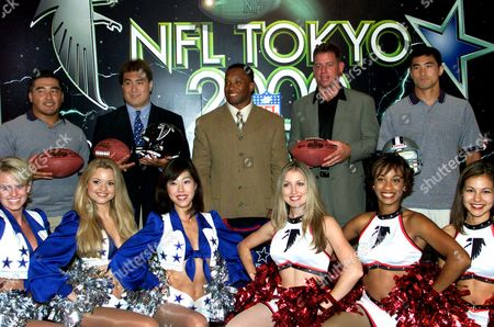 MITA Atlanta Falcons running back Jamal Anderson, center, and Dallas Cowboys quarterback Troy Aikman, second from right, are joined by Japanese football players and their cheerleaders during a news conference at Tokyo Dome Hotel in Tokyo on the American Bowl, an NFL preseason exhibition match slated for Sunday, Aug. 6. Japanese football players, Masato Itai, right, and Masafumi Kawaguchi, left, will be playing with the Cowboys while Nacho Abe, second from left, will be joining the Falcons. Japanese coed Tomoko Mita, third from left, will be cheering for the Cowboys