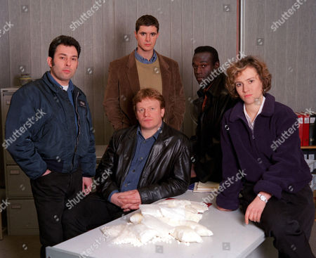 Stock Photo of 'The Knock'  TV - 1999 - Picture Shows: Enzo Squillino Jnr., Daniel Brown, Steve Toussaint, Sarah Malin and Mark Lewis Jones (Middle).