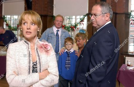 'Coronation Street'  TV - 2004 - Sally is furious to discover that the headmaster of Oakhill School Mr Austin is to offer Chesney the chance of a scholarship. Cilla and Les gloat over the news. Sally Webster [Sally Whittaker], Chesney Brown [Sam Aston], Cilla Brown [Wendi Peters] and Mr Austin [David Fleeshman].