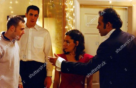 'Coronation Street'  TV - 2004 - An angry Tyrone Dobbs (ALAN HALSALL) bursts into Dev Alahan (JIMMI HARKISHIN) and Maya Sharma (SASHA BEHAR) engagement party.  He accuses Maya of killing his dog Monica. Waiter [Nick Lenthall] looks on.