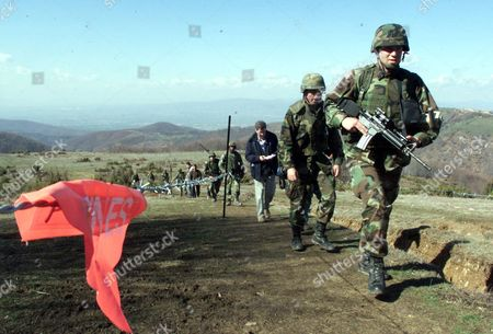 Stock Image of Lt. Jeff Wilbur from Anapolis, Maryland leads a patrol team of U.S. soldiers while patroling Kosovo's border with Macedonia, near Mijak