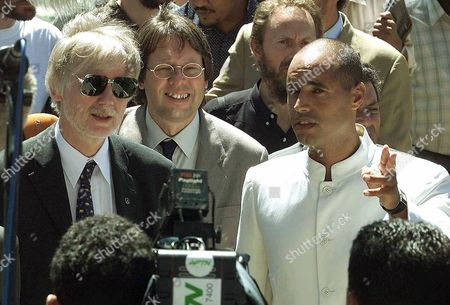GADHAFI Finnish Foreign Minister Erkki Tuomioja, left, German Deputy Foreign Minister Ludger Volmer, center, and the Libyan leader's son Seif-el Islam Gadhafi talk prior to the hand over of the four hostages in Tripoli Libya, Tuesday, Sept.12, 2000. The four former hostages were handed over to their respectives government's representatives at a ceremony