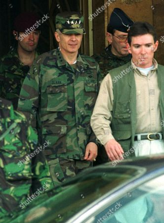 CLARK NATO supreme allied commander Europe, General Wesley K. Clark, leaves the parliament building surrounded by his bodyguards after a meeting with Macedonian president Kiro Gligorov in Skopje, Macedonia