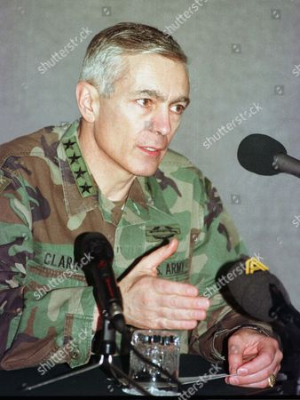 """The Supreme Allied Commander for Europe General Wesley K. Clark during a press conference in Skopje, Macedonia . Clark said """"NATO will guarantee the security of Macedonia if necessary"""