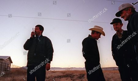 ZUNIGA Police officer Jose Zuniga, left, reports a traffic accident in a Mennonite camp outside Cuauhtemoc, Mexico, as Mennonite farmers gather at right, . At the request of Mennonite leaders worried about crime, Mexican police now patrol the camps