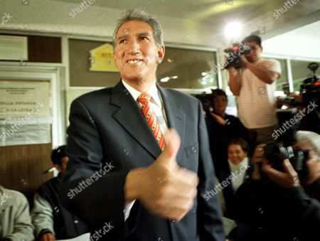 MONTIEL Institutional Revolutionary Party (PRI) candidate for governor of the state of Mexico, Arturo Montiel, gives a thumbs-up to photographers after casting his vote in Toluca, Mexico, . Many see Sunday's state elections in Mexico as a warm-up for the 2000 presidential elections