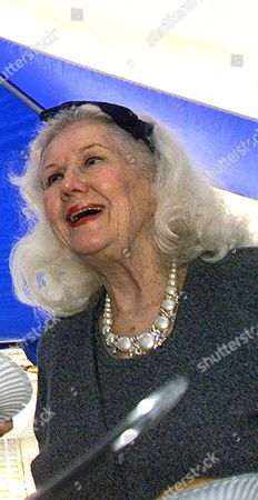 Stock Photo of BUCHANAN MAYO Veteran actress Virginia Mayo attends a picnic campaign fundraiser in La Canada, Calif., on June 19, 1999. Mayo, the stunning blonde actress who brought beauty and romance to films of the 1940s and 1950s with such co-stars as James Cagney, Bob Hope, Gregory Peck, Danny Kaye and Ronald Reagan, died, at a nursing home in Thousand Oaks,Calif. She was 84