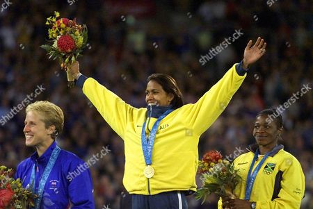 FREEMAN MERRY GRAHAM Australia's Cathy Freeman stands center with her gold medal for the women's 400 meter race alongside silver medal winner Lorraine Graham of Jamaica, right, and bronze medal winner Katharine Merry, of Great Britain during medal awards ceremonies at the Summer Olympics, at Olympic Stadium in Sydney