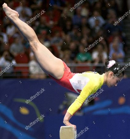 XUAN Liu Xuan of China competes on the balance beam during the women's gymnastic team finals at the 2000 Summer Olympic Games, in Sydney