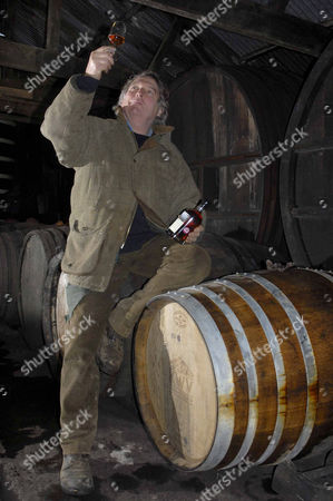 "Julian Temperley with his ""Shipwreck"" brandy and one of many barrels he obtained from Branscombe beach."