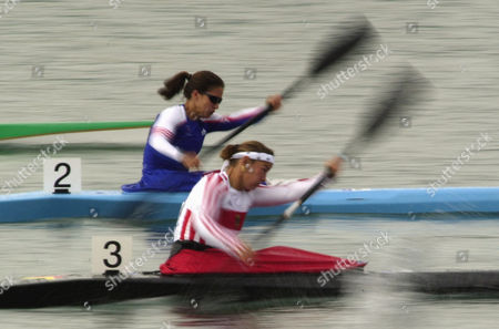 Stock Picture of HEMMINGS MUCKE Germany's Manuela Mucke, right, and Anna Hemmings of Great Britain, during their 500m K1 heat, at the Sydney International Regatta Center in Penrith, Australia. Mucke qualified for the semifinal, Hemmings did not qualify