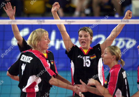 Stock Photo of Germany's Angelina Gruen, centre, Christina Benecke, left and Tanya Hart celebrate during the preliminary round in Sydney's Olympic Park while on their way to beating Peru . Germany won the match 25-16, 25-19, 26-16