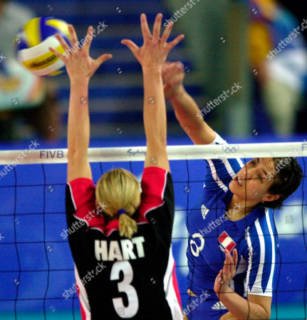 Stock Image of Germany's Tanya Hart, left, trys to block the ball hit by Peru's Milagros Moy during the preliminary round match in Sydney's Olympic park . Germany won the match 25-16, 25-19, 26-16