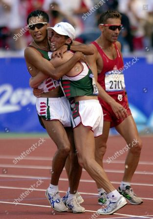 Mexico's Bernardo Segura, left, is embraced by teammate Noe Hernandez, center, after Segura won the gold medal in the 20km walk at the Summer Olympics, at Olympic Stadium in Sydney. Poland's Robert Korzeniowski, right, won the silver and Hernandez won the bronze. Segura was later disqualified and the gold handed to Korzeniowski