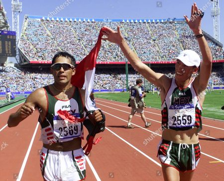 SEGURA HERNANDEZ Mexico's Bernardo Segura, left, celebrates with teammate Noe Hernandez after Segura won the gold medal in the 20km walk at the Summer Olympics, at Olympic Stadium in Sydney. Segura was disqualified moments after crossing the finish line first at the Olympic Games Friday. The disqualification sent the gold medal to Robert Korzeniowski of Poland, who finished just behind Segura in a tight race
