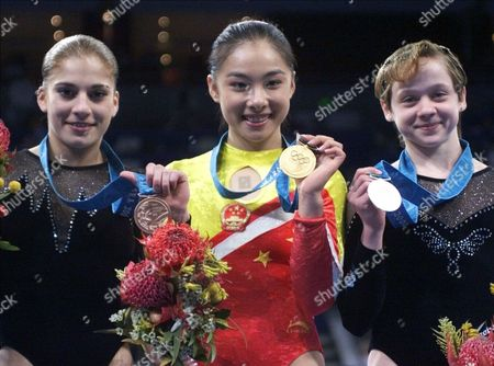 PRODOUNOVA LIU LOBAZNIUK Winners in the balance beam competition show of the medals during the gymnastics apparatus finals at the 2000 Summer Olympic Games in Sydney, . They are from left: Bronze medalist, Elena Prodounova of Russia; gold medalist, Liu Xuan of China and silver medalist Ekaterina Lobazniuk of Russia