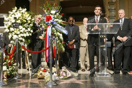 Gil Garcetti and floral tributes at the star of Johnny Grant