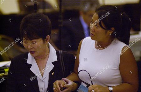 FUJIMORI HIGUCHI Keiko Fujimori, right, daughter of former President Alberto Fujimori, is accompanied by her mother and congresswoman Susana Higuchi, after she testified before a congressional committee investigating ex-spy chief Vladimiro Montesinos, at the Congress in Lima, Peru Wednesday, Jan.10, 2001