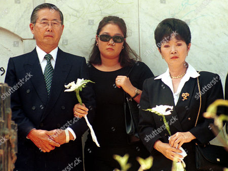 Stock Photo of FUJIMORI SOFIA HIGUCHI Former President of Peru, Alberto Fujimori, left, attends the funeral of his former father-in-law with his daughter, Keiko Sofia, center, and his former wife, Susana Higuchi, in Lima, Peru, in this Feb. 15, 2000 photo. A former intelligence agent said in comments aired that she saw Higuchi naked and cowering in a basement cell at army intelligence headquarters in 1995, after Higuchi alleged that she was tortured by intelligence agents more than 500 times during her former husband's authoritarian government