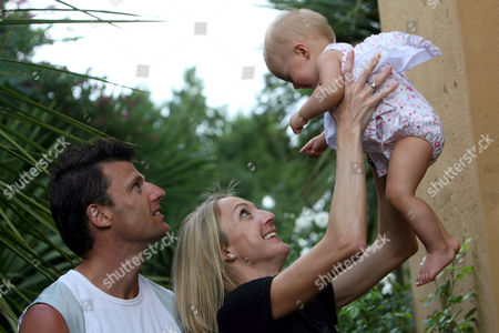 Paula Radcliffe with husband Gary Lough and their 1 year-old daughter Isla at their hotel