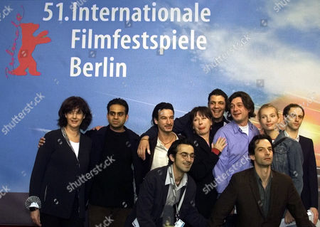 """ACTORS Part of the cast of the European co-production movie """"Sweet Home"""" pose for the media prior to news conference of their movie at the Berlin film festival """"Berlinale"""" on . """"Sweet Home"""" is one of the 23 movies in the competition. From left Producer Uta Ganschow from Germany, actor Neil D Souza from India, actor David Monteiro of Portugal, producer Thanassis Karathos from Greece, actress Monika Hansen from Germany, actor Mehdi Nebbou from Syria, director Filippos Tsitos of Greece, actor Harvey Friedman of the U.S., actress Nadja Uhl and actor Mario Mentrup, both from Germany"""