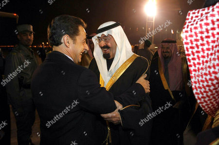 French President Nicolas Sarkozy (L) is Welcomed by Saudi Arabia's King Abdullah Bin Abd Al Aziz Al-Saud Upon His Arrival at Riyadh Airport for a Two-Day Official Visit in the Capital of Saudi Arabia.