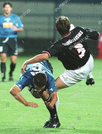 SOSA ZWIRGZDAUSKAS Roberto Sosa of Italy's Udinese Calcio, left and Tomas Zwirgzdauskas of Hoop Polonia challenge for the ball during the first leg, first round, UEFA Cup soccer game Hoop Polonia vs Udinese Calcio in Plock, Poland, Thursday Sept.14, 2000. Udinese won the game 1:0
