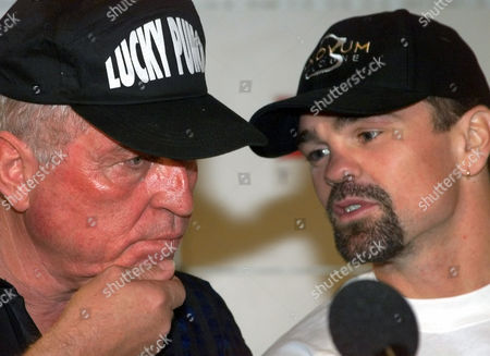 OTKKE WEGNER German boxer Sven Ottke, right, talks to his coach Ulli Wegner, left, during a press conference in Magdeburg, eastern Germany, . Ottke will defend his IBF super-middleweight worldchampion title against Thomas Tate from U.S. on Saturday night in Magdeburg