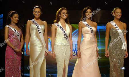 UNIVERSE Miss Universe finalists from left to right are, Miss India, Celina Jaitly; Miss Venezuela, Eva Ekval; Miss Puerto Rico, Denise Quinones; Miss Greece, Evelina Papantoniou, and Miss U.S.A. Kandace Krueger wait for the announcement of the winner, in Bayamon, Puerto Rico. Miss Puerto Rico Denise Quinones was crowned the winner