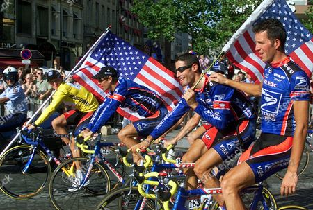 DERAME Tour de France winner Lance Armstrong of the U.S. left, riding down the Champs Elysees avenue with teammates, from left, Frankie Andreu, of the U.S., George Hincapie of the U.S., and Pascal Derame, of France, after the 20th and final stage of the Tour de France cycling race, in Paris, France. While Floyd Landis accuses Lance Armstrong of taking drugs and approving systematic doping, former teammates say that image doesn't conform with their experience
