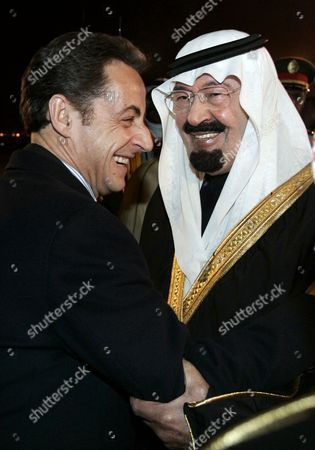 Saudi Arabia's King Abdullah bin Abd Al Aziz Al Saud and French President Nicolas Sarkozy pose after the King awarded Sarkozy with the King Abdelaziz medal at the King's residence in Riyadh.