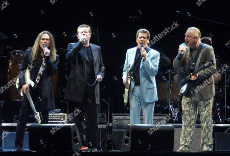 THE EAGLES Members of legendary rock group The Eagles, left to right, Timothy Schmidt, Don Henley, Glen Frey and Joe Walsh, perform during a concert at Moscow's Olympic Stadium, to star their European tour