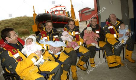 Stock Image of L-R proud Dads with their babies are Steve Sheales and Casey, Thomas Williams and Charlie, Owen Nutt and Grace, Richard Thurlow and Niamh, Andrew Hewitt and Sidney.