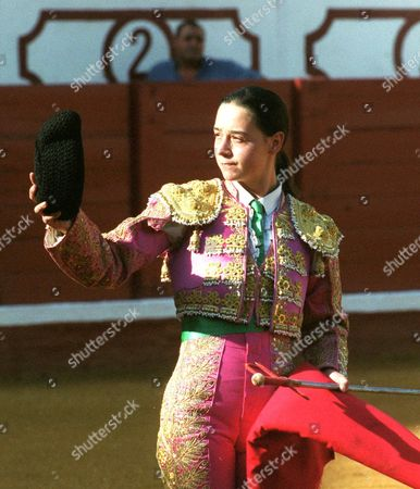 EVA FLORENCIA Apprentice Italian female bullfighter Eva Bianchini, 20, who fights under the name Eva Florencia, salutes spectators before a bullfight in Manzanares, central Spain, . Bianchini, who ran away from home in Florence Italy to become a bullfighter in Spain, is undaunted by the recent retirement of Spain's top female matador, Cristina Sanchez, who said she was fed up with toreros who wouldn't fight alongside her