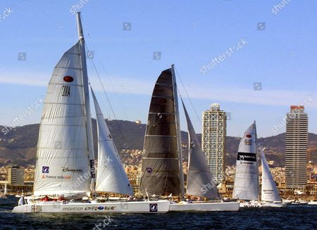 """RACE The catamarans, from left, Innovation Explorer, jointly skippered by France's Loick Peiron and Skip Novak of the United States, Team Adventure, skippered by Cam Lewis of the United States, and Warta-Polpharma, skippered by Poland's Roman Paszke, leave Barcelona's Olympic port, to kick off a round-the-world sailing race called """"The Race"""". Five catamarans set off from Barcelona Sunday in what is being billed as the first round-the-world millennium race"""
