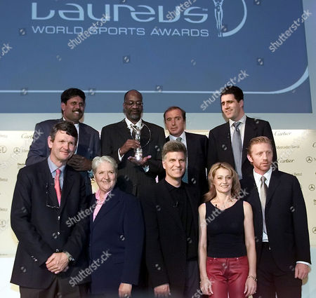 SPORT STARS The members of the World Sports Academy who took part at the celebration for the nomination of the years winner in all categories of the Laureus Sports Award pose for the photographers in Berlin, . First row from left to right: South African Rugby player Morne du Plessis, Australian swimmer Dawn Fraser, former US Swim star Mark Spitz, former Romanian gymnastic star Nadja Comaneci and former German tennis star Boris Becker. Second row from left to right: Cricket star Kapil Dev from India, former US runner Edwin Moses, Argentinian Rugby-player Hugo Porta, Spanish cyclist Miquel Indurain