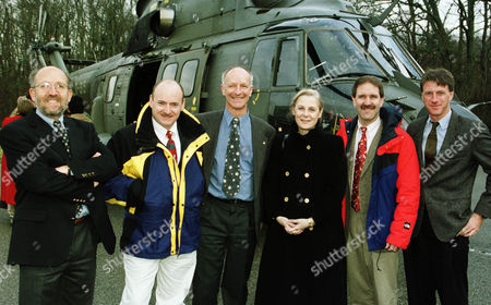 FAMILY PICTURE The crew of the special Discovery space mission STS -103, sent to repair the telescope Hubble, arrives at the astronomical observatory of Geneva, Switzerland on Tuesday Feb.15, 2000. From left to right in front of a Swiss army helicopter 'Puma' are :- Michel Mayor, Director of the Observatory, Scott Kelly, pilot of Discovery, Claude Nicollier, Swiss member of the crew, Martine Brunschwick-Graf, Genevan State councillor, John Grunsfeld, crewmember, and Michael Foale,crewmember