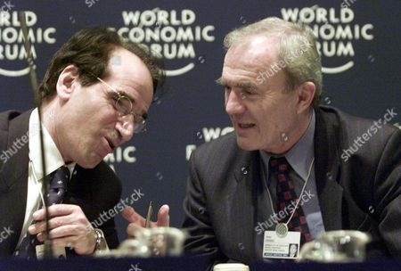 """ISSING FITOUSSI Otmar Issing of Germany, member of the executive board and chief economist of the European Central Bank, right, chats with Jean-Paul Fitoussi, President of a leading French economic institute as they attend the forum """"Strong Dollar, Weak Euro-or Vice Versa"""" at the Davos World Economic Forum on"""