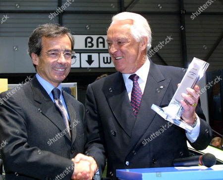 """PEUGEOT REVAT SAINT-GEOURS Jean Marie Revaz, right, president of the Geneva Motor Show gives the award for the """"Cabriolet of the Year"""" to Frederic Saint-Geours, chief of Peugeot, for the Peugeot 206 Cabriolet during a ceremony at the Motor Show of Geneva, Switzerland on"""