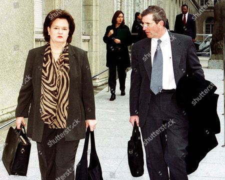 Stock Picture of HAYES WALSH Rita Hayes, left, US Trade Ambassador and Neil Walsh, US press officer arrive at the World Trade Organization (WTO ) for the WTO's general council at Geneva, Switzerland