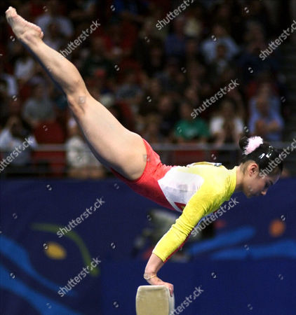 Liu Xuan Liu Xuan of China competes on the balance beam during the women's gymnastic team finals at the 2000 Summer Olympic Games in Sydney. A decade after taking gold in Sydney, Liu, the 30-year-old former gymnast, has launched a second career in Hong Kong, the financial center, which is also a hub for the Chinese-language entertainment industry