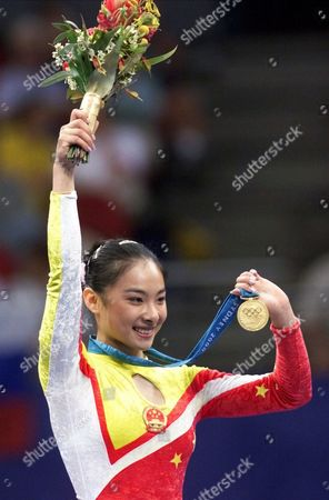 Liu Xuan Liu Xuan of China shows her gold medal for the balance beam during the gymnastics apparatus finals at the 2000 Summer Olympic Games in Sydney. A decade after taking gold in Sydney, Liu, the 30-year-old former gymnast, has launched a second career in Hong Kong, the financial center, which is also a hub for the Chinese-language entertainment industry