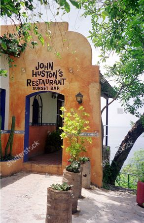 """MISMALOYA FOR IMMEDIATE RELEASE--John Huston's Restaurant, named for the director of the movie """"Night of the Iguana,"""" stands on the site in Mismaloya, Mexico, June 2000, of the 1963 movie production that starred Richard Burton, Ava Gardner and Deborah Kerr"""