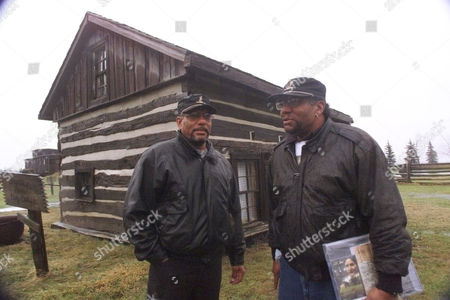 WALLS Winston Walls, left, and Allen Walls stand outside the house built by their great grandfather John Freeman Walls in Lakeshore Township, Ontario in Feb. 2001. The cabin was built in 1846, a year after the former slave escaped from North Carolina. Today the cabin is part of an Underground Railroad museum built by Walls' descendants